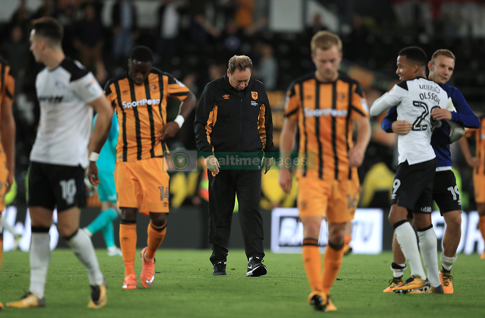 Hull City manager Leonid Slutsky (centre) is dejected after the final whistle