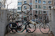 SHENYANG, CHINA - (CHINA OUT) <br /> <br /> Worthless Bikes For Plugging Loopholes on Fence<br /> <br /> Worthless bikes are hung on fence on April 15, 2013 in Shenyang, Liaoning province of China. The 103 bikes are used to plug loopholes on the 200-meters-long fence.<br /> ©ChinaFoto/Exclusivepix