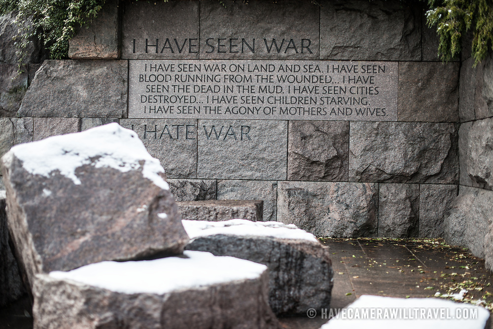 Granite stones and an inscription at the FDR Memorial on the banks of the Tidal Basin after a recent snowfall.