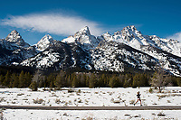 Sandy Kreif takes advantage of unseasonably warm weather Sunday for a jog along the inner park loop road pathway in Grand Teton National Park. Temperatures topped out at 60 degrees, a record high for Nov. 26.