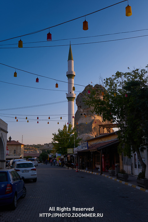 Street of Ortahisar city and cave castle at sunset in Cappadocia
