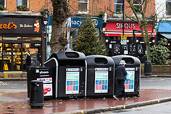 London, December 31 2017. Rubbish and old clothes mount up at some recycling sites in London, with others appearing to have had their contents recently collected. PICTURED: The community recycling site in West Hampstead appears to have been recently cleared. © SWNS
