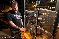 Paul Adams of Confederate Motorcycles checking out a cut away motor at the pre-party for the Handbuilt Motorcycle Show at Revival Cycles. Austin, TX. April 9, 2015.  Photography ©2015 Michael Lichter.