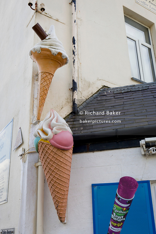 Ice cream cones on the wall of a beach cafe, on 13th September 2018, in Barmouth, Gwynedd, Wales.