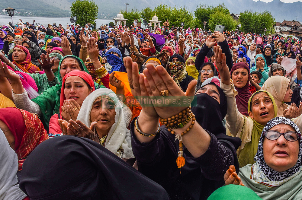 April 25, 2017 - Srinagar, Jammu and Kashmir, India - Mehraj-u-Alam was celebrated in Kashmir, which marks ascension day, the journey from Heaven to Earth of the Prophet Mohammed, at the Hazratbal Shrine in the outskirts of Srinagar, India. Hundreds of Muslims from different parts of Kashmir visit the Hazratbal shrine in Srinagar to pay obeisance on the Mehraj-ul-Alam. The relic is displayed to the devotees on important Islamic days such as the Mehraj-ul-Alam.(Credit Image: © Yawar Nazir/NurPhoto via ZUMA Press)