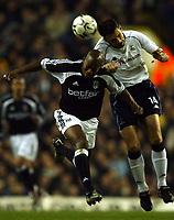 Photo. Javier Garcia<br />24/02/2003 Tottenham v Fulham, FA Barclaycard Premiership, White Hart Lane<br />Fulham scorer Luis Boa Morte, left and Spurs' Gus Poyet challenge