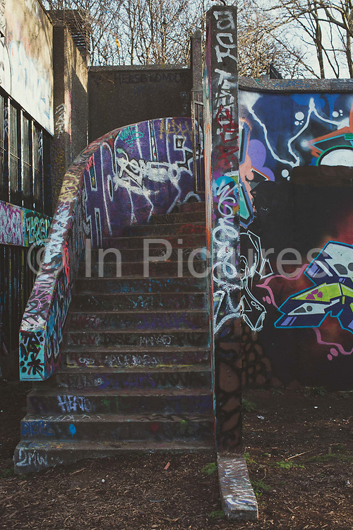 Concrete steps covered in colourful graffiti at Trellick Tower on the 26th March 2018 in West London, United Kingdom. Trellick Tower is Grade II listed tower block on the Cheltenham Estate in Kensal Town, London. Opened in 1972, it had been commissioned by the Greater London Council and designed in the Brutalist style by architect Ernő Goldfinger.