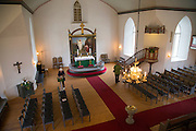 People visiting Bronnoy Church, Bronnoysund, Nordland, Norway built in 1870