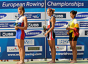 Plovdiv BULGARIA.   left. RUS W1X, Silver Medalist,Julia LEVINA  centre, CZE W1X, Gold Medalist, Mirka KNAPKOVA , right, LTU Donata VISTARTAINTE, medal ceremony women's single sculls .   2011 FISA European Rowing Championships, Plovdiv Rowing Centre   Sunday  18/09/2011  [Mandatory Credit; Peter Spurrier: Intersport Images]  Original Camera File No.  2011011987.jpg