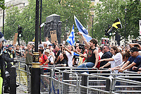 crowds outside Downing Street during the anti-lockdown march 'Unite for Freedom' while shouting on a mega-phone against Boris Johnson & the Government.photo by Krisztian Elek