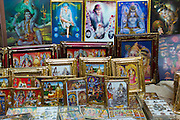 Religious pictures of Lord Shiva and wife Parwati on sale at stall by the Golden Temple in holy city of Varanasi, Benares, Northern India