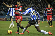 Karl Henry (QPR) gets the ball away from Lucas Joao (Sheffield Wednesday) during the Sky Bet Championship match between Sheffield Wednesday and Queens Park Rangers at Hillsborough, Sheffield, England on 23 February 2016. Photo by Mark P Doherty.