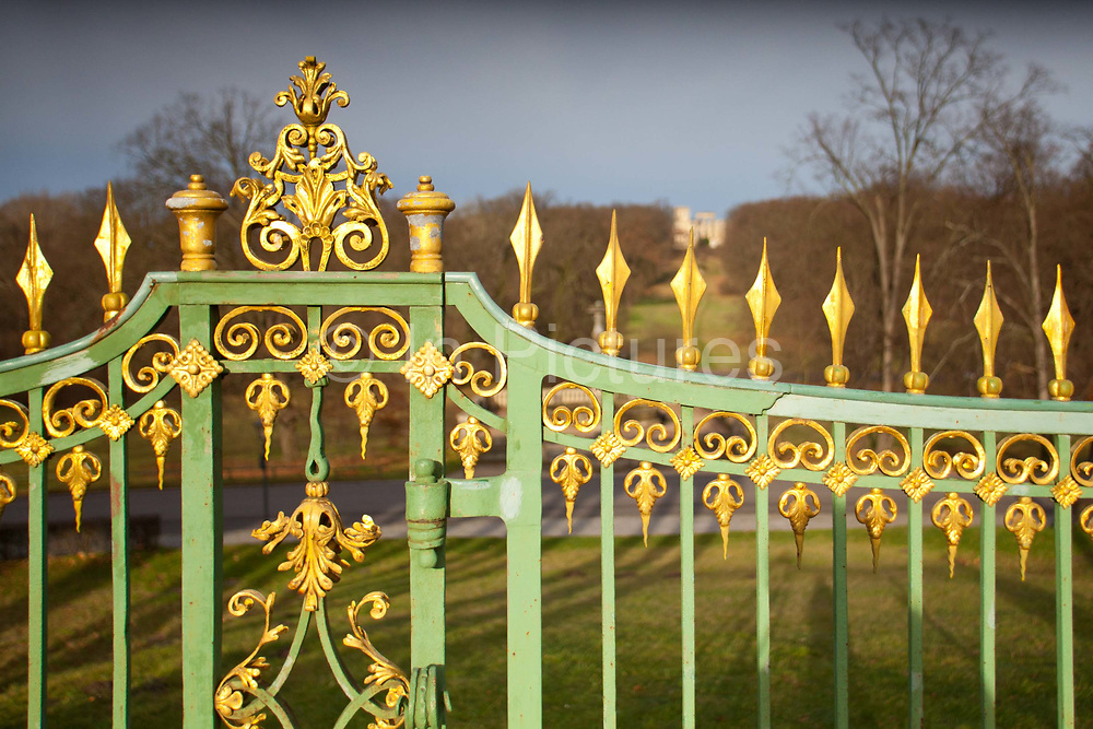 Exterior shot of the golden gilded gates in front of the Sans Souchi Palace which means without worries Palace, Potsdam, Brandenburg, Germany.