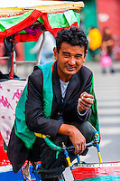 Bicycle rickshaw drivers, Beijing East Road, Lhasa, Tibet (Xizang), China.