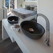Interior of a loft, bedroom with bath, modern design