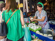 18 APRIL 2015 - BANGKOK, THAILAND:  A coconut ice cream vendor in the Chatuchak Weekend Market in Bangkok. Chatuchak Weekend Market in Bangkok is reportedly the largest market in Thailand and the world's largest weekend market. Frequently called J.J., it covers more than 35 acres and contains upwards of 5,000 stalls.       PHOTO BY JACK KURTZ