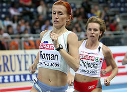 Slovenian long run athlete Sonja Roman followed by Lidia Chojecka of Poland in the Qualification when she qualified for finals at the 1st day of  European Athletics Indoor Championships Torino 2009 (6th - 8th March), at Oval Lingotto Stadium,  Torino, Italy, on March 6, 2009. (Photo by Vid Ponikvar / Sportida)