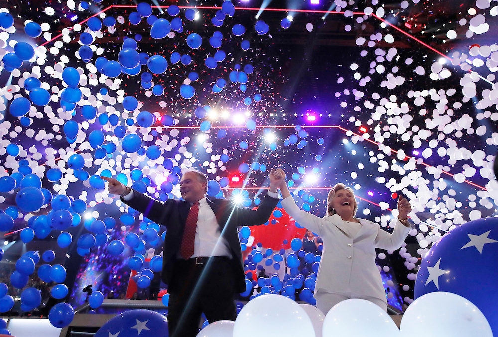 Democratic presidential nominee Hillary Clinton and her vice presidential running mate Senator Tim Kaine celebrate among balloons after she accepted the nomination on the fourth and final night at the Democratic National Convention in Philadelphia, Pennsylvania, U.S. July 28, 2016.    REUTERS/Jim Young