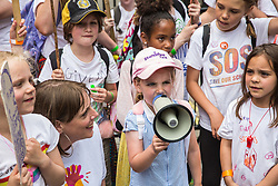 London, UK. 5 July, 2019. Children attend a protest organised by the Save Our Schools campaign group outside Downing Street against schools being forced to close early on Fridays due to funding cuts and to highlight the government's responsibility to care for and educate the nation's children on Friday afternoons.