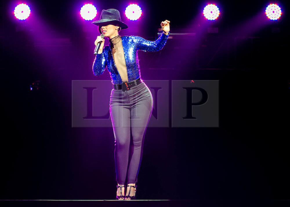 """© Licensed to London News Pictures. 30/05/2013. London, UK.   Alicia Keys performing live at The O2 Arena.  Alicia Keys is an American pianist, R&B singer-songwriter,musician,record producer and actress. She is touring to promote her fifth studio album """"Girl on Fire"""". Photo credit : Richard Isaac/LNP"""