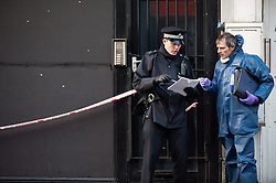 © licensed to London News Pictures. London, UK. 15/02/12. Police guard social club where gunshots can be seen through black boarding. Crime scene in Stoke Newington, London where a man in his 40s was shot in the face & multiple rounds fired into a social club off Burma Road, N16 early this morning. Police were called at 1:25AM and the man's injuries are described as 'not life threatening'. The man remains in hospital & no arrests have yet been made. Photo credit: Jules Mattsson/LNP