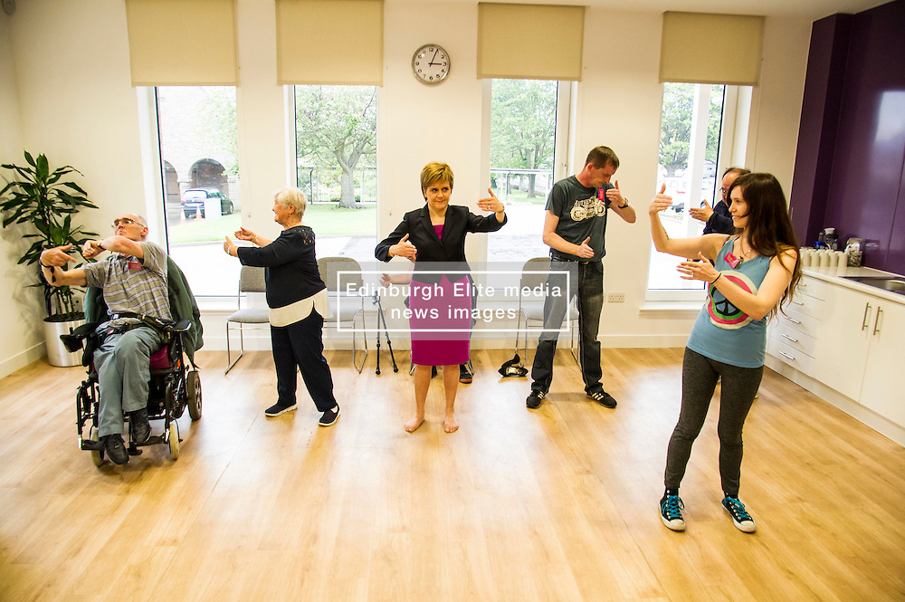 Pictured: Nicola Sturegoan joined in a Health and Wellbeing tai chi class<br /> <br /> The First Minister Nicola Sturgeon, MSP, joined people supported by the Thistle Foundation to bury a time capsule to mark the opening of a new health and social care centre. <br /> Ger Harley   EEm 14 June 2016