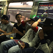 Teenage baseball fans on the metro heading to the New York Mets V San Francisco Giants Baseball game at Citi Field, Queens, New York. 21st April 2012. Photo Tim Clayton