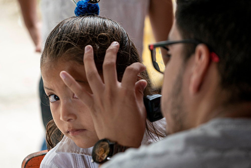 Bianca Ramirez with Central  American Medical Outreach, CAMO and Bryan Tabora, with INSA work with children at Margarita School in Las Crucitas, Copan Honduras on Friday Sept. 27, 2019.  Photo Ken Cedeno