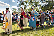 Native Americans dancers from the Arapahoe people dressed in traditional costumes prepare to perform a fancy dance at the Indian Village during Cheyenne Frontier Days July 25, 2015 in Cheyenne, Wyoming. Frontier Days celebrates the cowboy traditions of the west with a rodeo, parade and fair.