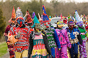 Cajun Mardi Gras revelers walk through the countryside going house to house during the Faquetigue Courir de Mardi Gras chicken run on Fat Tuesday February 17, 2015 in Eunice, Louisiana. The traditional Cajun Mardi Gras involves costumed revelers competing to catch a live chicken as they move from house to house throughout the rural community.