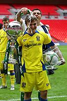 Football -  FA Trophy Final - Stevenage Borough vs Barrow<br /> Carlsberg Man of the Match Paul Rutherford of Barrow holds both Trophy's at Wembley Stadium