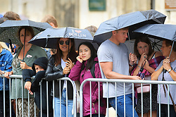 Crowds stand in the rain outside York Minister ahead of the wedding of singer Ellie Goulding to Caspar Jopling.