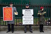 Religious protesters exclaim that we need God, not the EU in Westminster on the day of the 'meaningful vote' when MPs will back or reject the Prime Minister's Brexit Withdrawal Agreement on 15th January 2019 in London, England, United Kingdom.