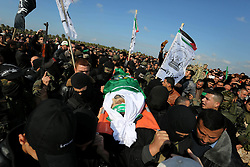 January 30, 2018 - Gaza City, Gaza Strip, Palestinian Territory - Palestinian militants from the Ezzedine al-Qassam Brigades, the armed wing of the Hamas movement carry the body of Hamas senior leader Imad al-Alami during his funeral in Gaza City on January 30, 2018. A senior Hamas official has died in Gaza three weeks after shooting himself in the head in what officials described as an accident, the Palestinian Islamist group announced. Alami was wounded on January 9 while ''inspecting his personal weapon in his home'' in Gaza, Hamas said at the time  (Credit Image: © Ashraf Amra/APA Images via ZUMA Wire)