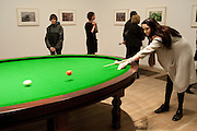 LILY COLE, PLAYING Gabriel Orozco's 'Carambole with a Pendulum? Gabriel Orozco reception, Tate Modern, London. 18 January 2010. .-DO NOT ARCHIVE-© Copyright Photograph by Dafydd Jones. 248 Clapham Rd. London SW9 0PZ. Tel 0207 820 0771. www.dafjones.com.