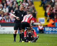 Leon Clarke of Sheffield Utd sits down injured during the English League One match at  Bramall Lane Stadium, Sheffield. Picture date: April 30th 2017. Pic credit should read: Simon Bellis/Sportimage