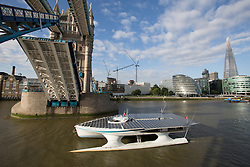 © Licensed to London News Pictures. 31/08/2013. London, UK. MS Tûranor PlanetSolar arrives on the River Thames in London for the first time ever and is seen passing under Tower Bridge. MS Tûranor PlanetSolar is the world's largest solar powered vessel and has broken the world record for crossing the Atlantic in 22 days. Its solar panels measure 512 square meters and can generate 480kWh on a sunny day.. Photo credit : Vickie Flores/LNP