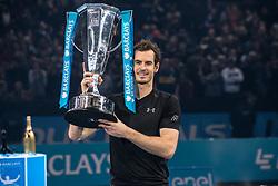 November 20, 2016 - London, United Kingdom - Andy Murray (SCO) wins the Championships against Novak Djokovic (SRB) and celebrates with the awards. arclays ATP Finals: Singles. (Credit Image: © Alberto Pezzali/Pacific Press via ZUMA Wire)