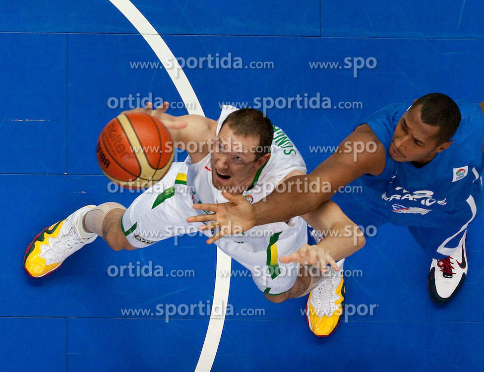 Darius Songaila of Lithuania vs Boris Diaw of France during basketball game between National basketball teams of Lithuania and France at FIBA Europe Eurobasket Lithuania 2011, on September 9, 2011, in Siemens Arena,  Vilnius, Lithuania. France defeated Lithuania 73-67.  (Photo by Vid Ponikvar / Sportida)