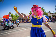 30 JUNE 2012 - PRESCOTT, AZ:  A clown waves to the crowd at the Prescott Frontier Days Rodeo Parade. The parade is marking its 125th year. It is one of the largest 4th of July Parades in Arizona. Prescott, about 100 miles north of Phoenix, was the first territorial capital of Arizona.    PHOTO BY JACK KURTZ