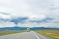 A semi truck on a lonely highway in Montana, USA.