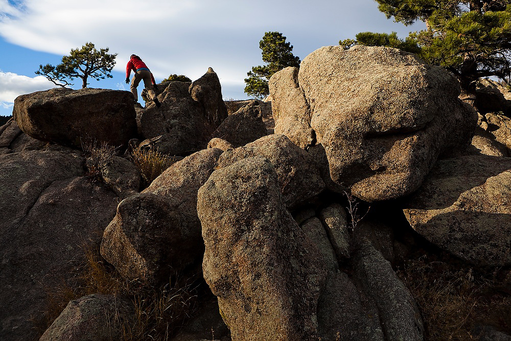 Grace Marx scrambles through the large boulders at the top of The Dome in Boulder Canyon near Boulder, Colorado.