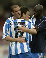 Photo Aidan Ellis, Digitalsport<br /> NORWAY ONLY<br /> <br /> Lincoln City v Huddersfield Town.<br /> Third Divison Play Off Semi Final 1st leg.<br /> 15/05/2004.<br /> Huddersfield's Andy Booth and David Holdsworth congratulate each other on victory