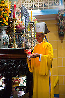 Cao Dai assistant priests prepare for the ceremony at the Great Divine Temple.