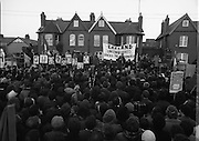 """H-Block Hunger-Strike Protest.   (M54)..1980..06.12.1980..12.06.1980..6th December 1980..In support of the prisioners on hunger strike in Northern Ireland a protest march was organised in Dublin. The march was to highlight the treatment of prisioners who wer on hunger strike and on the """"blanket"""" protest. Part of the prisioner demand was that they be treated as political prisioners and not as criminals or terrorists..Image shows An tAthair Piaras"""