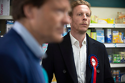 © Licensed to London News Pictures 01/05/2021. Sidcup, UK. Laurence Fox pops into a pharmacy on the High Street. London mayoral candidate and Reclaim Party leader Laurence Fox visiting Sidcup in South East London today with Reform UK Party leader Richard Tice. Photo credit:Grant Falvey/LNP