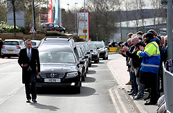 Members of the public applaud as the Gordon Banks funeral cortege passes by the bet365 Stadium, Stoke.