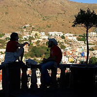 Americas, Mexico, Guanajuato. A couple silhouetted against the backdrop of romantic Guanajuato, A UNESCO World Heritage Site.