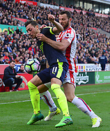 Mersut Ozil of Arsenal battles with Erik Pieters of Stoke city (r). Premier league match, Stoke City v Arsenal at the Bet365 Stadium in Stoke on Trent, Staffs on Saturday 13th May 2017.<br /> pic by Bradley Collyer, Andrew Orchard sports photography.