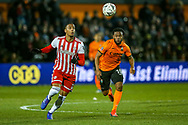 Barnet forward Shaquile Coulthirst (10) tussles with Brentford defender Chris Mepham (6) for the ball during the The FA Cup fourth round match between Barnet and Brentford at The Hive Stadium, London, England on 28 January 2019.